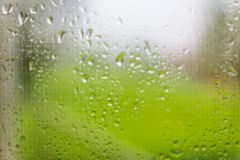 Water drops on window glass Stock Photos