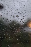 Water drops on the window. After rain. Evening time Royalty Free Stock Image