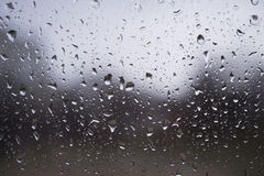Water drops on the window in rainy day Stock Photos