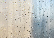 Water drops on the window surface. Dew drops on the window glass surface Stock Photography
