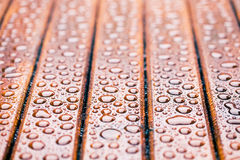 Water drops on wooden garden table Royalty Free Stock Photo