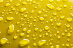 Water drops on yellow royalty free stock photo