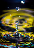 Water Drops yellow. Photography water drops colors yellow blue red abstract green orange Royalty Free Stock Image