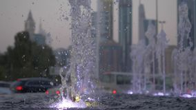 Water of dry fountain in the park close-up. Water shooting out of a fountain. Streams of fountain close-up. Slow motion. Water of dry fountain in the park close stock footage