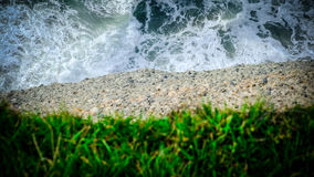 Water, earth and grass. closeup of a cliff. Cape farewell, new zealand Royalty Free Stock Image