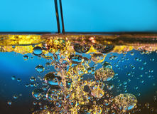Water en olie Stock Foto