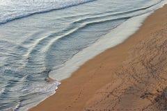 Water en zand Stock Foto