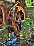 Water Energy Wheel. Turning water wheel for power or energy Stock Image