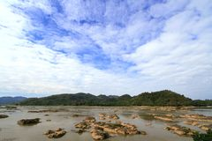 Water eroded rocks and islets in mekong river Stock Image