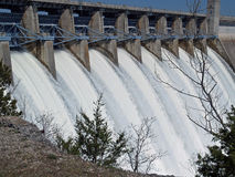 Water escape. White water gushing through flood gates at this dam royalty free stock photos