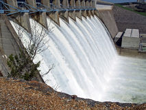 Water escaping. Water flowing over flood gates at this dam Stock Image