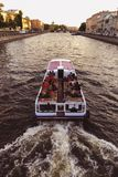 Water excursions along on the boat the rivers and canals by historical places of St. Petersburg, Russia.  stock photography