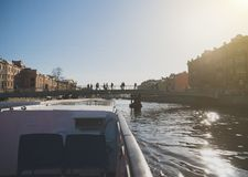 Water excursions. Water excursions along the rivers and canals of St. Petersburg. Gorstkin bridge royalty free stock photography