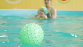 Water Exercises of Baby with Coach in the Pool stock footage