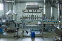 Water factory - Water bottling line for processing and bottling pure spring water into small bottles Stock Photography