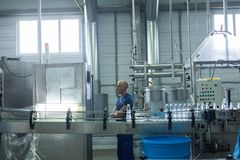 Water factory - Water bottling line for processing and bottling pure spring water into small bottles Royalty Free Stock Image