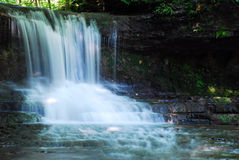 Water fall. This is a small water fall, It steps down to the creek it feeds Stock Photo