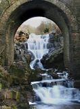 Water Fall through arch. Longe exposure Capture taken in Cumbri, England stock images