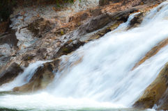 Water fall as a tourist destination for a family holiday. Royalty Free Stock Image