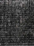 Water fall on dark stone tile texture Stock Photo