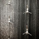 Water fall divers. Statues diving down a waterfall Dubai mall UAE Stock Image