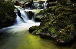 Water Fall Near Rock during Day Time Royalty Free Stock Photography