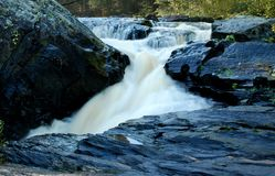 Water Fall Over Black Slate Rocks Royalty Free Stock Images