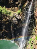Water fall and rainbow under the sunlight Royalty Free Stock Photos