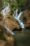 Water fall in spring season located in deep rain forest jungle. Beautiful landscape Stock Photos