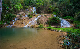 Water fall in spring season located in deep rain forest jungle. Beautiful landscape Royalty Free Stock Photo