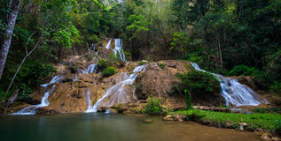 Water fall in spring season located in deep rain forest jungle. Beautiful landscape Royalty Free Stock Images