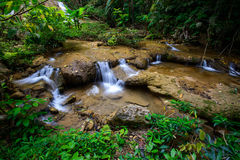 Water fall in spring season located in deep rain forest jungle. Beautiful landscape Stock Photo