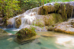 Water fall in spring season located in deep rain forest jungle, Thailand Royalty Free Stock Photography