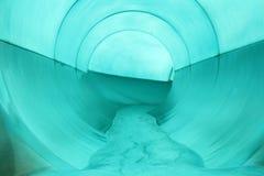 Water fall tunnel in swimming pool. Blue Water fall tunnel in swimming pool royalty free stock photography
