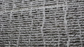 Water fall Waterfall on dark stone tile wall stock footage
