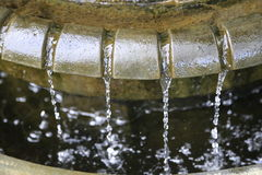 Water falling from ancient roman fountain Stock Photography