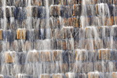 Water falling on bricks abstract. Close up of water falling on top of a brick wall Stock Images