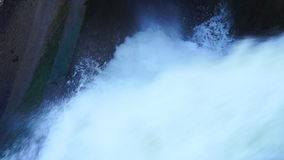 Water falling down. Open dam discharged water from the lake reservoir stock footage