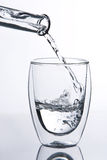 Water falling into glass Royalty Free Stock Photo