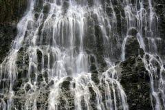 Water falling in Karekare Falls New Zealand Royalty Free Stock Photo