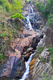 Water falling from a mountain rock. Thailand Royalty Free Stock Images
