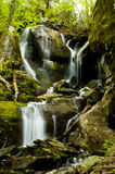 Water falling off steep rocks. Royalty Free Stock Images