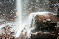 Water Falling over Rocks Stock Images