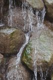 Water falling over rocks Royalty Free Stock Photo