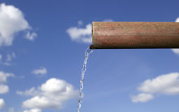 Water is falling from pipe Royalty Free Stock Photography