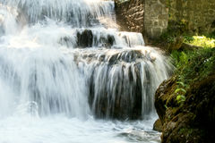 Water falling on rocks. Cold water falling with high speed on rocks Stock Photos