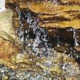 Water falling from rocks drips drops waterfall. Water falling from rocks stock image