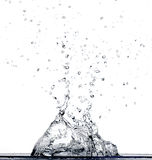 Water Falling In Water. Water splashing into water, on a white background Royalty Free Stock Photography