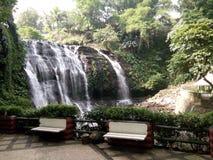 Water falls bench Royalty Free Stock Photo