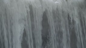 Water falls from the dam in the river stock footage